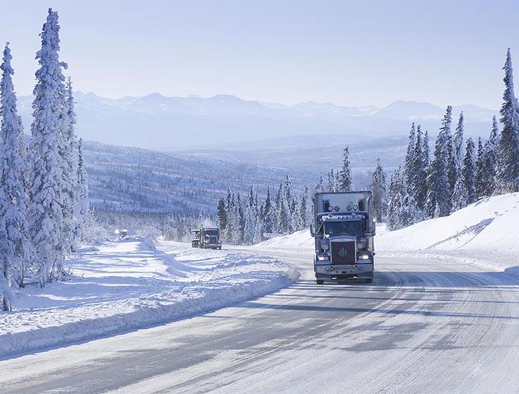semi-truck driving in the winter