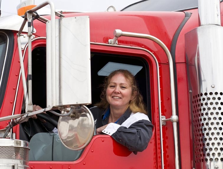 women driving a semi-truck