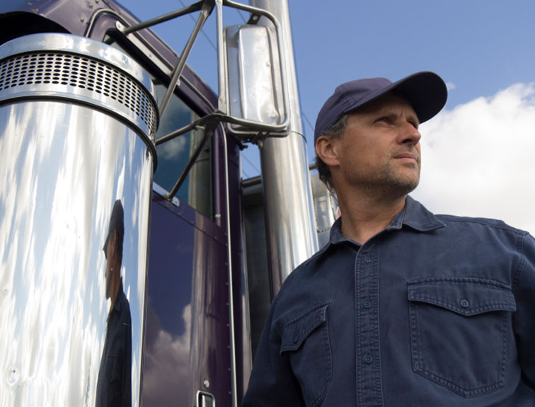 trucker by truck starring into distance
