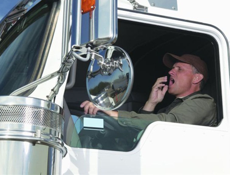 truck driver yawning at the wheel