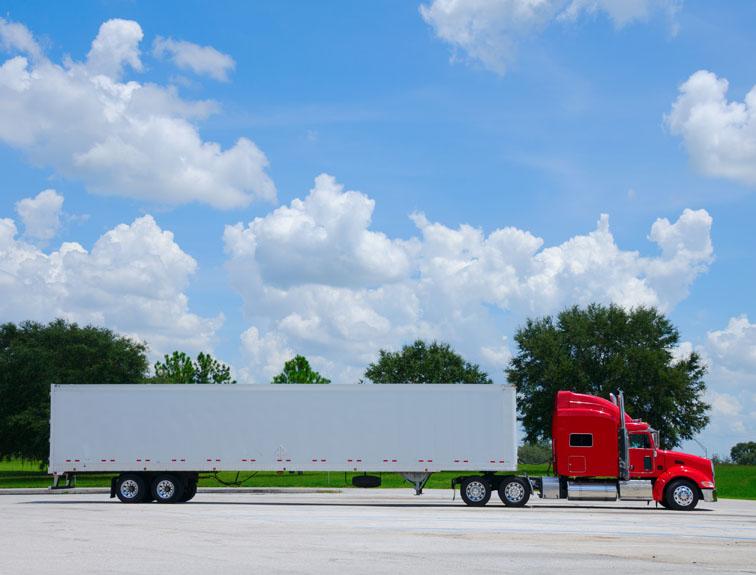 Semi in trucking yard on a sunny day