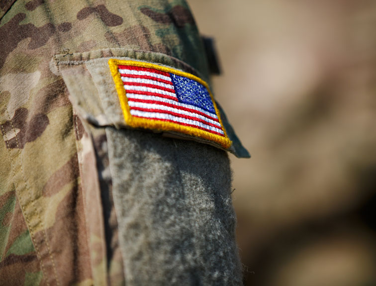 Military uniform with American flag patch